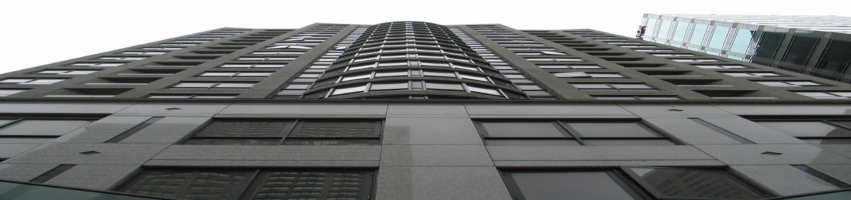 Looking up at a condominium building